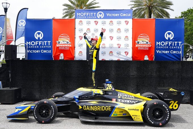IndyCar driver Colton Herta celebrates after winning the Grand Prix of St. Petersburg, Sunday, April 25, 2021 in St. Petersburg, Fla. (Luis Santana/Tampa Bay Times via AP)