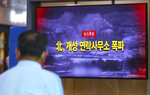 A man watches a TV screen showing a news program about the demolition of the inter-Korean liaison office building, at the Seoul Railway Station in Seoul, South Korea, Tuesday, June 16, 2020. North Korea blew up an inter-Korean liaison office building just north of the heavily armed border with South Korea on Tuesday in a dramatic display of anger that sharply raises tensions on the Korean Peninsula and puts pressure on Washington and Seoul amid deadlocked nuclear diplomacy. The letters read