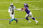 Carolina Panthers quarterback Teddy Bridgewater (5) runs from Minnesota Vikings linebacker Eric Kendricks , right, during the first half of an NFL football game, Sunday, Nov. 29, 2020, in Minneapolis. (AP Photo/Charlie Neibergall)
