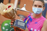 Romania's Simona Halep poses with her trophy after beating Czech Republic's Karolina Pliskova during their final match at the Italian Open tennis tournament, in Rome, Monday, Sept. 21, 2020. (Alfredo Falcone/LaPresse via AP)