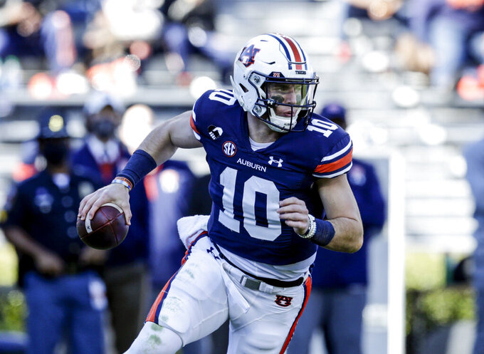 Auburn quarterback Bo Nix (10) rolls out to pass during the second half of an NCAA college football game against Texas A&M on Saturday, Dec. 5, 2020, in Auburn, Ala. (AP Photo/Butch Dill)