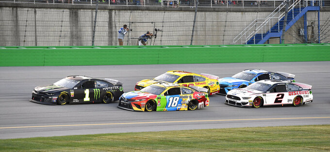 Kurt Busch (1) leads Kyle Busch (18), Joey Logano (22), Brad Keselowski (2) and Martin Truex Jr. (19) following a restart during the NASCAR Cup Series auto race at Kentucky Speedway in Sparta, Ky., Saturday, July 13, 2019. (AP Photo/Timothy D. Easley)