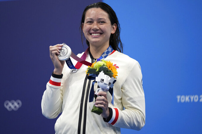 Siobhan Bernadette Haughey of Hong Kong holds up her silver medal from the women's 200-meter freestyle final at the 2020 Summer Olympics, Wednesday, July 28, 2021, in Tokyo, Japan. (AP Photo/Matthias Schrader)