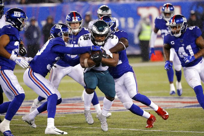 Philadelphia Eagles running back Boston Scott (35) runs with the ball through New York Giants defense in the second half of an NFL football game, Sunday, Dec. 29, 2019, in East Rutherford, N.J. (AP Photo/Seth Wenig)