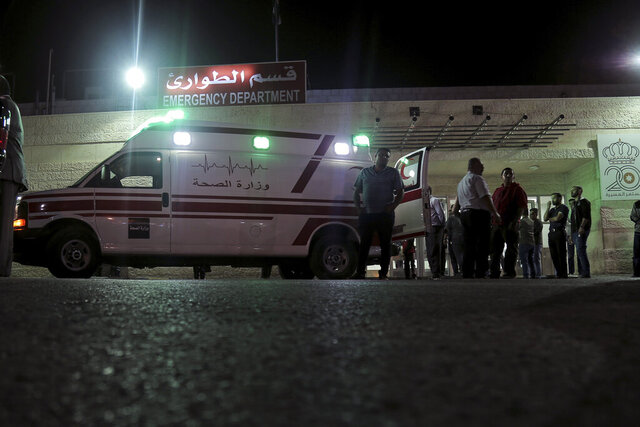 FILE - In this Nov. 6, 2019 file photo, an ambulance is parked in front of the Jerash Government Hospital, where people stabbed in a knife attack were taken in Jerash, Jordan. On Tuesday, Jan. 12, 2021, Jordan sentenced a man to death by hanging for the 2019 stabbing attack at a popular tourist site that wounded eight people, including foreign tourists and their guide. (AP Photo/Raad Adayleh, File)