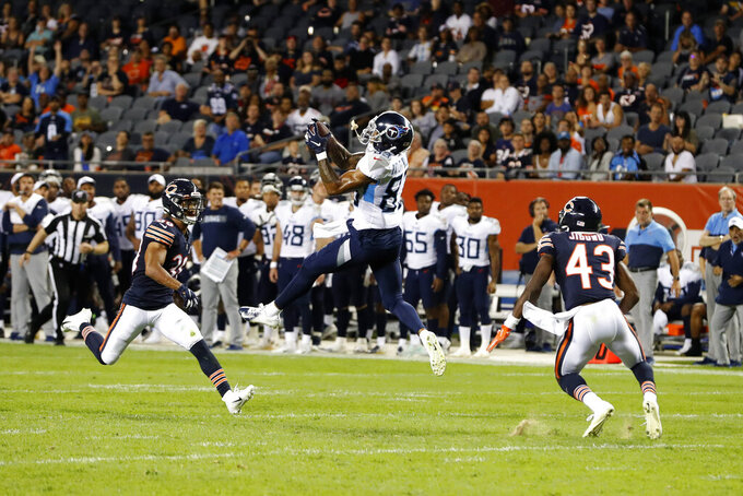 Tennessee Titans wide receiver Anthony Ratliff-Williams (83) makes a catch betweem Chicago Bears defensive backs Clifton Duck, left, and Doyin Jibowu (43) during the second half of an NFL preseason football game Thursday, Aug. 29, 2019, in Chicago. Tennessee won 19-15. (AP Photo/Charles Rex Arbogast)