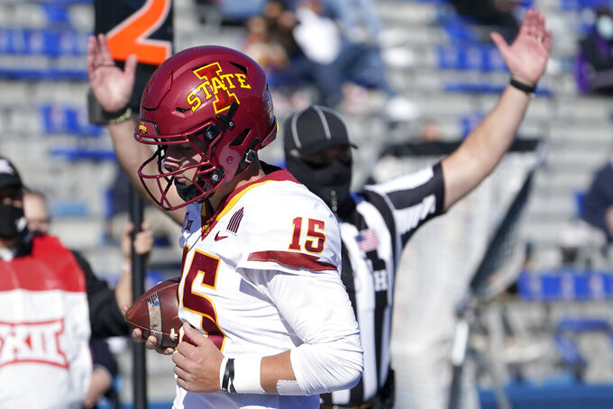 Iowa State quarterback Brock Purdy (15) scores a touchdown during the first half of an NCAA college football game against Kansas in Lawrence, Kan., Saturday, Oct. 31, 2020. (AP Photo/Orlin Wagner)
