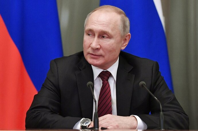 Russian President Vladimir Putin attends a new cabinet meeting in Moscow, Russia, Tuesday, Jan. 21, 2020. Putin formed his new Cabinet Tuesday, replacing many of its members but keeping his foreign, defense and finance ministers in place. (Alexei Nikolsky, Sputnik, Kremlin Pool Photo via AP)