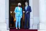 Greek Prime Minister Kyriakos Mitsotakis , right, welcomes Lithuanian Prime Minister Ingrida Simonyte during their meeting in Athens, on Thursday, July 15, 2021. (AP Photo/Petros Giannakouris)