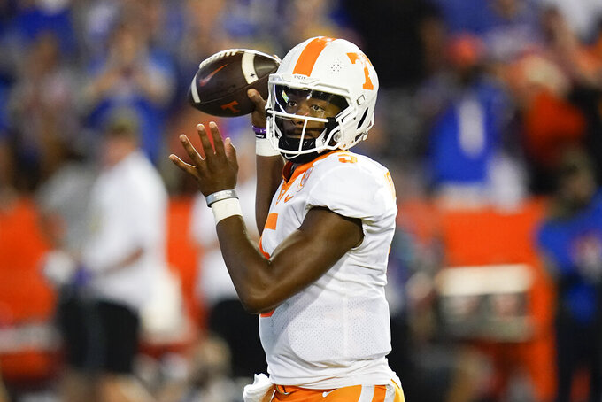 Tennessee quarterback Hendon Hooker throws a pass during the first half of an NCAA college football game against Florida, Saturday, Sept. 25, 2021, in Gainesville, Fla. (AP Photo/John Raoux)