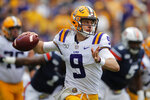 LSU quarterback Joe Burrow (9) scrambles in the first half of an NCAA college football game against the Auburn in Baton Rouge, La., Saturday, Oct. 26, 2019. (AP Photo/Gerald Herbert)