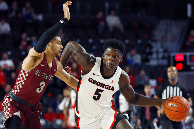 Georgia's Anthony Edwards (5) moves the ball past North Carolina Central guard Ty Graves during an NCAA college basketball game Wednesday, Dec. 4, 2019, in Athens, Ga. (Joshua L. Jones/Athens Banner-Herald via AP)