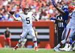 Cleveland Browns quarterback Case Keenum throws during the first half of an NFL football game against the New York Giants, Sunday, Aug. 22, 2021, in Cleveland. (AP Photo/David Dermer)