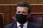 Popular Party leader of the opposition Pablo Casado laughs behind his face mask during a parliamentary session in Madrid, Spain, Wednesday Oct. 21, 2020. Spanish Prime Minister Pedro Sanchez faces a no confidence vote in Parliament put forth by the far right opposition party VOX. (AP Photo/Manu Fernandez, Pool)