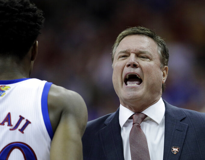 Kansas coach Bill Self talks to players during the first half of the team's NCAA college basketball game against Iowa State in the Big 12 men's tournament final Saturday, March 16, 2019, in Kansas City, Mo. (AP Photo/Charlie Riedel)