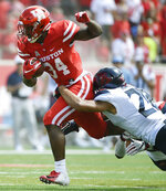 Houston running back Mulbah Car, left, is tackled by Arizona safety Isaiah Hayes during the first half of an NCAA college football game, Saturday, Sept. 8, 2018, in Houston. (AP Photo/Eric Christian Smith)