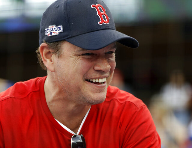 "FILE - In this Sunday, Oct. 28, 2018 file photo, Actor Matt Damon waits for Game 5 of the World Series baseball game in Los Angeles. Damon has on Wednesday, May 13, 2020 described living in Ireland during the country's coronavirus lockdown as like being in a ""fairy tale"" during a surprise radio interview. The Hollywood star and his family were in Dublin, where he had been filming Ridley Scott's ""The Last Duel,"" before travel restrictions were imposed worldwide. (AP Photo/David J. Phillip, file)"