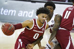 Arkansas forward Justin Smith (0) drives against South Carolina forward Jalyn McCreary (4) during the second half of an NCAA college basketball game Tuesday, March 2, 2021, in Columbia, S.C. (AP Photo/Sean Rayford)