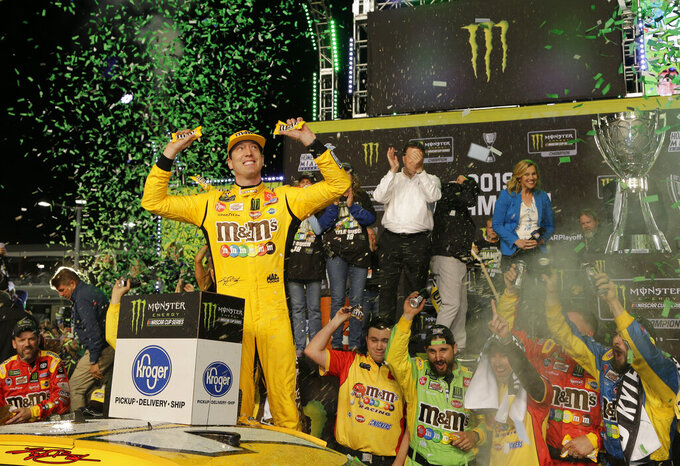 Kyle Busch celebrates in Victory Lane after winning the NASCAR Cup Series auto racing season championship on Sunday, Nov. 17, 2019, at Homestead-Miami Speedway in Homestead, Fla. (AP Photo/Terry Renna)