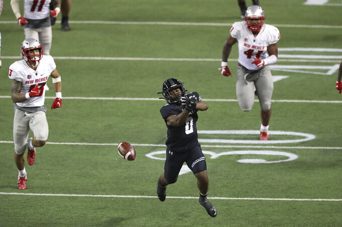 Hawaii running back Dae Dae Hunter (0) can't pull in a pass during the second quarter of the team's NCAA college football game against New Mexico, Saturday, Nov. 7, 2020, in Honolulu. (AP Photo/Marco Garcia)