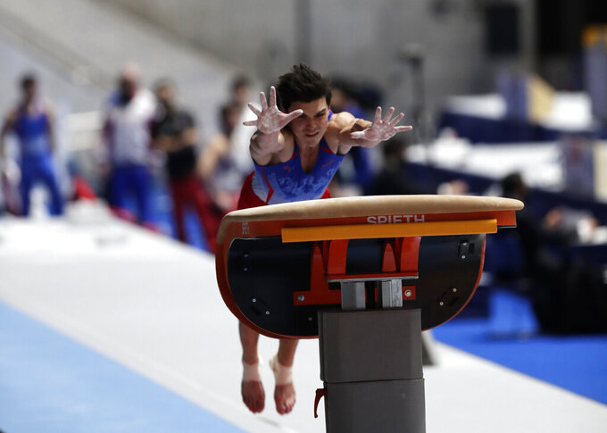 Artur Dalaloyan of Russia competes in the vault event of an international gymnastics meet in Tokyo on Sunday, Nov. 8, 2020. Gymnasts from four countries of China, Russia, U.S. and Japan performed in the meet at Yoyogi National Stadium First Gymnasium, a venue planned to be used in the Tokyo 2020 Olympics in the summer 2021. (AP Photo/Hiro Komae)