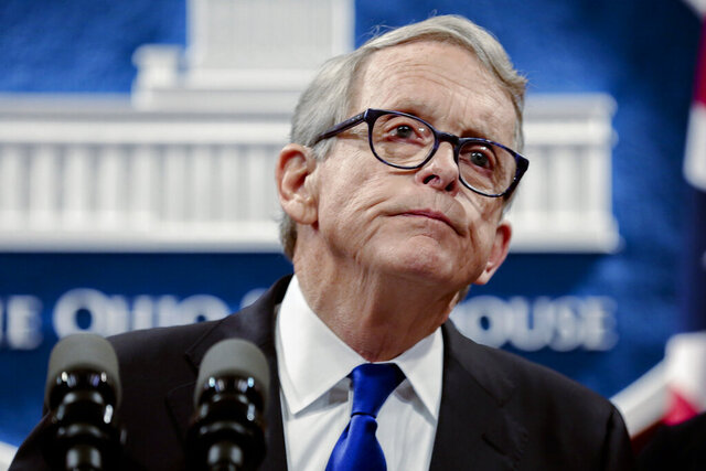 "FILE - Ohio Gov. Mike DeWine pauses while speaking about the people of Dayton following the Dayton Mass Shooting on Tuesday, Aug. 6, 2019, at the Ohio Statehouse in Columbus, Ohio. DeWine has signed into law a gun rights bill eliminating an individual's duty to retreat before using force. The measure expands the so-called ""stand your ground"" right from an individual's house and car to any place a person lawfully has the right to be. The Republican governor's decision followed months of saying any new gun legislation should include his proposals for  for toughening background checks and boosting penalties for felons committing new crimes with guns. (Joshua A. Bickel /The Columbus Dispatch via AP, File)"