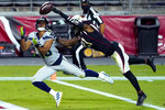 Seattle Seahawks wide receiver Tyler Lockett, left, pulls in a touchdown catch as Arizona Cardinals cornerback Patrick Peterson defends during the first half of an NFL football game, Sunday, Oct. 25, 2020, in Glendale, Ariz. (AP Photo/Rick Scuteri)