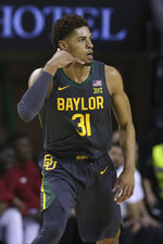 Baylor guard MaCio Teague (31) gestures after making a three point basket in the first half of an NCAA college basketball game against Oklahoma Monday, Jan. 20, 2020, in Waco, Texas. (AP Photo/ Jerry Larson)