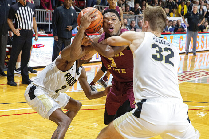Purdue guard Eric Hunter Jr. (2) and center Matt Haarms (32) steal the ball from Florida State guard Trent Forrest (3) with seconds left in overtime in an NCAA college basketball game at the Emerald Coast Classic in Niceville, Fla., Saturday, Nov. 30, 2019. Florida State won 63-60 in overtime. (AP Photo/Mark Wallheiser)