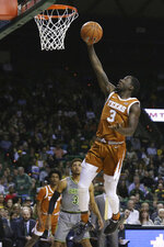 Texas guard Courtney Ramey, right, scores past Baylor guard MaCio Teague, left, in the first half of an NCAA college basketball game, Saturday, Jan. 4, 2020, in Waco, Texas. (AP Photo/Rod Aydelotte)