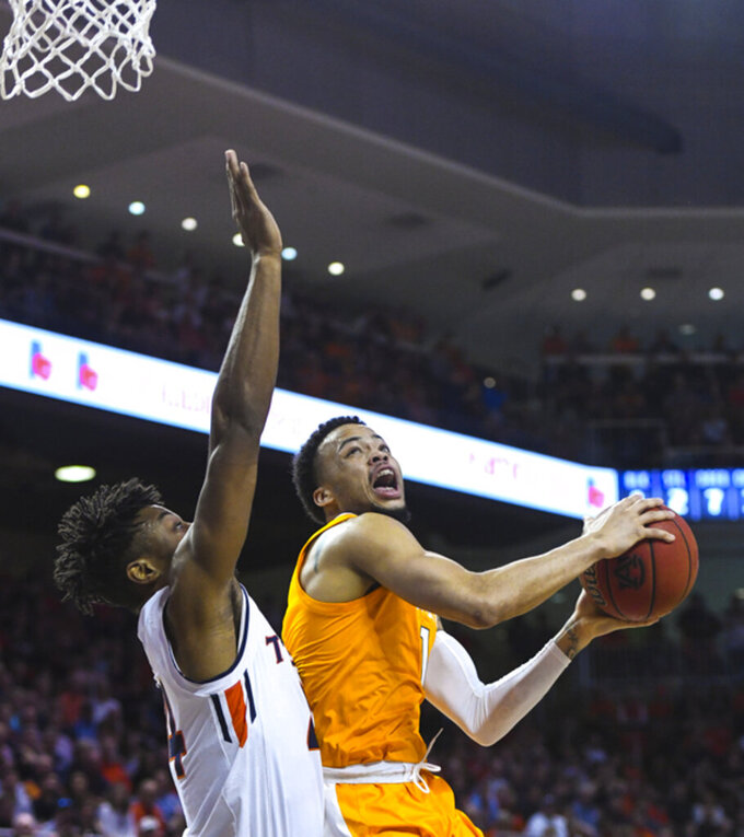 Auburn forward Anfernee McLemore (24) defends as Tennessee guard Lamonte Turner (1) looks to shoot during the first half of an NCAA college basketball game Saturday, March 9, 2019, in Auburn, Ala. (AP Photo/Julie Bennett)