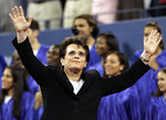 Billie Jean King waves to the crowd during the dedication ceremony for the USTA National Tennis Center re-named in her honor at the US Open tennis tournament in New York, Monday, Aug. 28, 2006. It's the 50th anniversary of Billie Jean King and eight other women breaking away from the tennis establishment in 1970 and signing a $1 contract to form the Virginia Slims circuit. That led to the WTA Tour, which offers millions in prize money. (AP Photo/Elise Amendola)