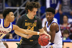 Kansas guard Devon Dotson, left, steals the ball from Baylor guard Matthew Mayer (24) while covered by Kansas guard Ochai Agbaji, right, during the first half of an NCAA college basketball game in Lawrence, Kan., Saturday, Jan. 11, 2020. (AP Photo/Orlin Wagner)