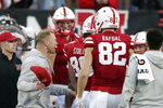 Nebraska head coach Scott Frost, front left, celebrates with his players on the sideline in the fourth quarter of an NCAA college football game against Minnesota in Lincoln, Neb., Saturday, Oct. 20, 2018. (AP Photo/Nati Harnik)