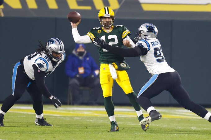 Green Bay Packers' Aaron Rodgers throws under pressure during the first half of an NFL football game against the Carolina Panthers Saturday, Dec. 19, 2020, in Green Bay, Wis. (AP Photo/Matt Ludtke)