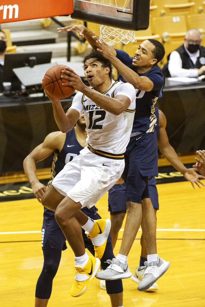 Missouri's Dru Smith shoots in front of Oral Roberts's Sheldon Stevens, right, during the second half of an NCAA college basketball game Wednesday, Nov. 25, 2020, in Columbia, Mo. (AP Photo/L.G. Patterson)