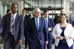 Attorney General Merrick Garland, center, along with Deputy Attorney General Lisa Monaco, right, and Acting Alcohol, Tobacco and Firearms (ATF) Director Marvin G. Richardson, left, leaves the Bureau of Alcohol, Tobacco and Firearms headquarters in Washington, Thursday, July, 22 2021. (Jim Lo Scalzo/Pool via AP)