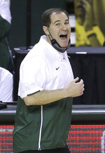 Baylor head coach Scott Drew calls in a play to his team in the first half of an NCAA college basketball game against Iowa State, Tuesday, Feb. 23, 2021, in Waco, Texas. (AP Photo/Jerry Larson)