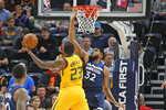 Utah Jazz forward Royce O'Neale (23) lays up the ball as Minnesota Timberwolves center Karl-Anthony Towns (32) defends in the first half during an NBA basketball game Monday, Nov. 18, 2019, in Salt Lake City. (AP Photo/Rick Bowmer)