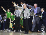 FILE - In this March 10, 2018, file photo, Marshall head coach Dan D'Antoni, front, tells his players to watch the play clock during a 67-66 win against Western Kentucky in an NCAA college basketball game in the finals of the Conference USA tournament in Frisco, Texas. D'Antoni was a 23-year-old assistant with the Marshall basketball program in 1970, when a plane carrying members of the Wichita State football team crashed in Colorado. Six weeks later, on Nov. 14, 1970, a plane carrying members of the Marshall football team crashed. As fate would have it, Marshall's first trip to the NCAA Tournament in 31 years means a date with Wichita State on Friday, March 16, 2018, in San Diego. (Austin Anthony/Daily News via AP, File)