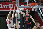 Utah center Branden Carlson (35) blocks a shot by Stanford forward James Keefe (22) during the second half of an NCAA college basketball game Thursday, Feb. 6, 2020, in Salt Lake City. (AP Photo/Rick Bowmer)