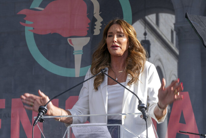FILE - In this Jan. 18, 2020, file photo, Caitlyn Jenner speaks at the fourth Women's March in Los Angeles. Jenner, and John Cox, two Republicans running to oust California Gov. Gavin Newsom, sought to make a fresh impression with voters Tuesday, May 4, 2021, with the release of new campaign ads, marking a new phase in the pending recall. (AP Photo/Damian Dovarganes, File)