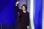 Sen. Amy Klobuchar, D-Minn., waves on stage Friday, Feb. 7, 2020, before the start of a Democratic presidential primary debate hosted by ABC News, Apple News, and WMUR-TV at Saint Anselm College in Manchester, N.H. (AP Photo/Charles Krupa)
