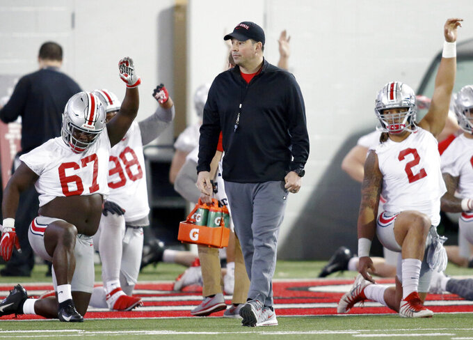 Ohio State NCAA college football head coach Ryan Day watches practice in Columbus, Ohio, Wednesday, March 6, 2019. (AP Photo/Paul Vernon)