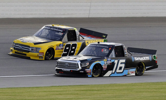 Grant Enfinger (98) and Austin Hill (16) drive during a NASCAR Truck Series auto race at Chicagoland Speedway in Joliet, Ill., Friday, June 28, 2019. (AP Photo/Nam Y. Huh)