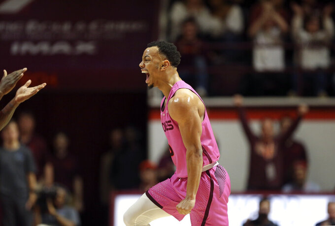 Virginia Tech's Justin Robinson celebrates one of his 3-point baskets against Syracuse during the first half of an NCAA college basketball game in Blacksburg, Va., Saturday, Jan. 26, 2019. (Matt Gentry/The Roanoke Times via AP)