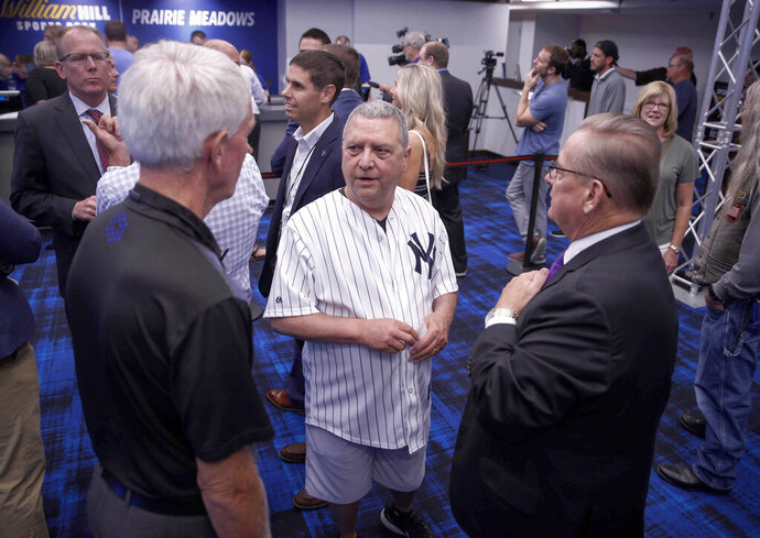 State senator Tony Bisagnano (D-Des Moines) donned a New York Yankees jersey to place the inaugural bet at the William Hill Sports Book at Prairie Meadows Casino in Altoona, Iowa, on Thursday, Aug. 15, 2019. Thursday was the first day for legalized sports betting in the state of Iowa.(Bryon Houlgrave/The Des Moines Register via AP)