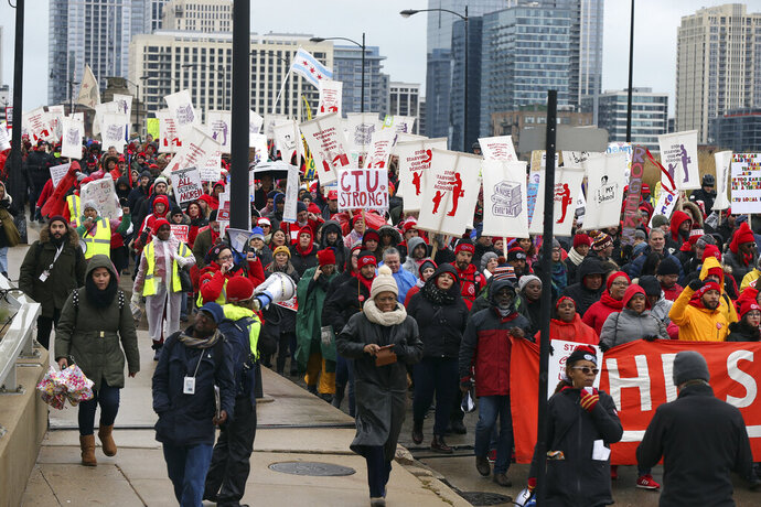 Striking Chicago Teachers Union members and their supporters march west on Roosevelt Road from Clark Street to Halsted Street in Chicago on Wednesday, Oct. 30, 2019. Chicago's mayor refused to grant striking teachers demands to add school days making up for two weeks of classes canceled by the walkout. The union's elected delegates voted Wednesday night to accept a tentative agreement with the district but said they won't end a strike without a commitment to make up classroom time from Mayor Lori Lightfoot. (Terrence Antonio James/Chicago Tribune via AP)