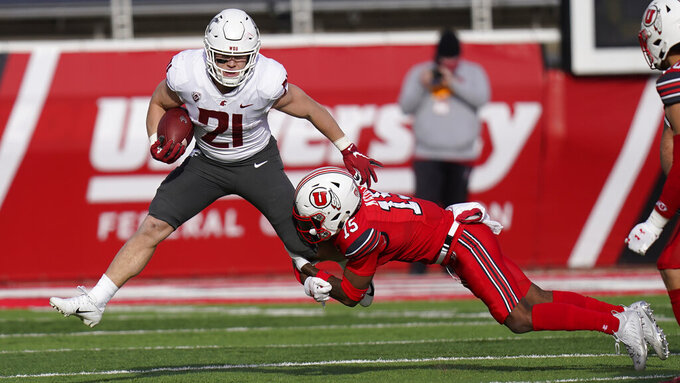 Utah cornerback Malone Mataele (15) tackles Washington State running back Max Borghi (21) during the second half of an NCAA college football game Saturday, Dec. 19, 2020, in Salt Lake City. (AP Photo/Rick Bowmer)