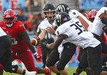 Old Dominion quarterback Blake LaRussa hands off to running back Jeremy Cox (35) during an NCAA college football game against Florida Atlantic on Saturday, Oct. 6, 2018, in Boca Raton, Fla. (Jim Rassol/South Florida Sun-Sentinel via AP)